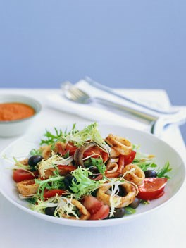 Barbecued squid, endive and olive salad with romesco sauce