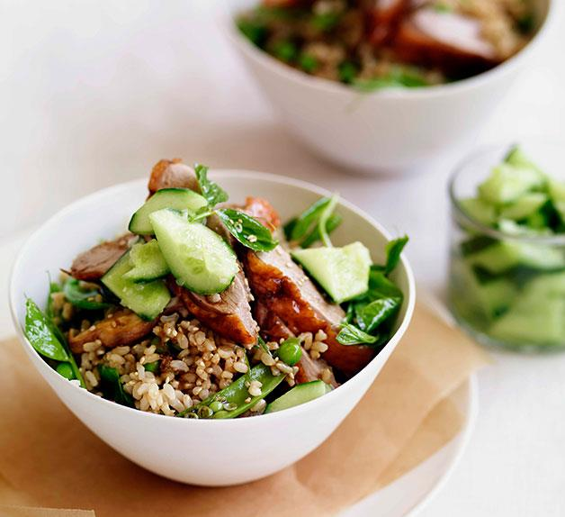 Chinese roast duck with brown rice, peas and cucumber
