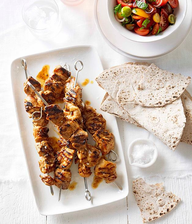 **Portuguese chicken skewers with tomato salad and flatbread**