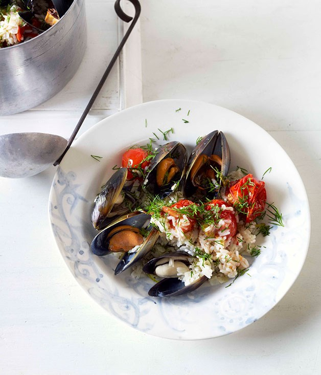 Mussels cooked in a tomato and rice pilaf with dill