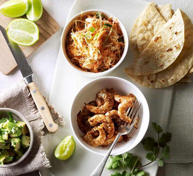 Soft prawn tacos with coleslaw, avocado and coriander