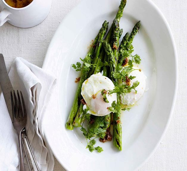 Asparagus with egg and garlic and anchovy butter