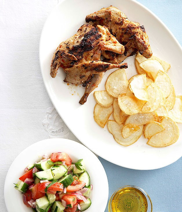 Piri piri quail with chips and tomato and cucumber salad