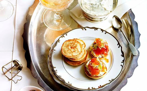 Blini with smoked trout, herbed crème fraîche and fennel salad