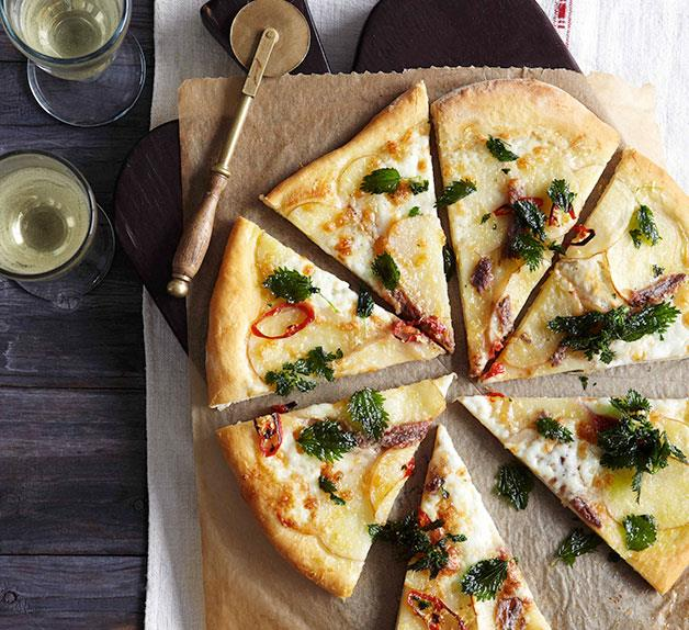 Potato, mozzarella and anchovy pizza with fried nettles
