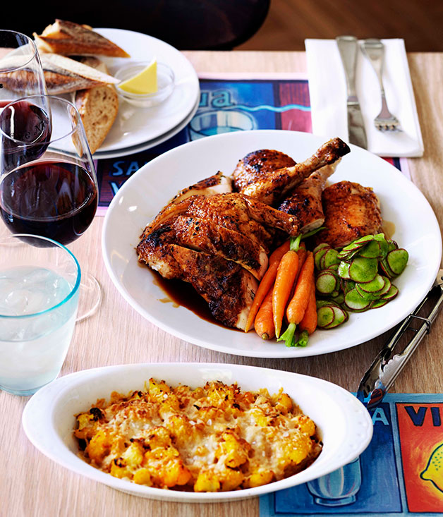 Roast Chicken With Confit Garlic Herbs Carrots And Radishes Gourmet Traveller