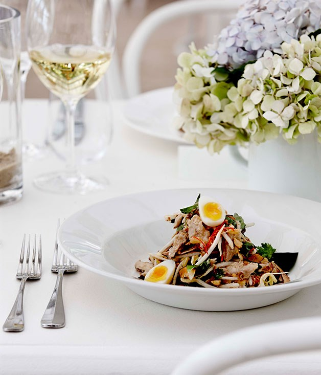 Poached chicken and coconut salad with smoked quail's eggs and Asian herbs