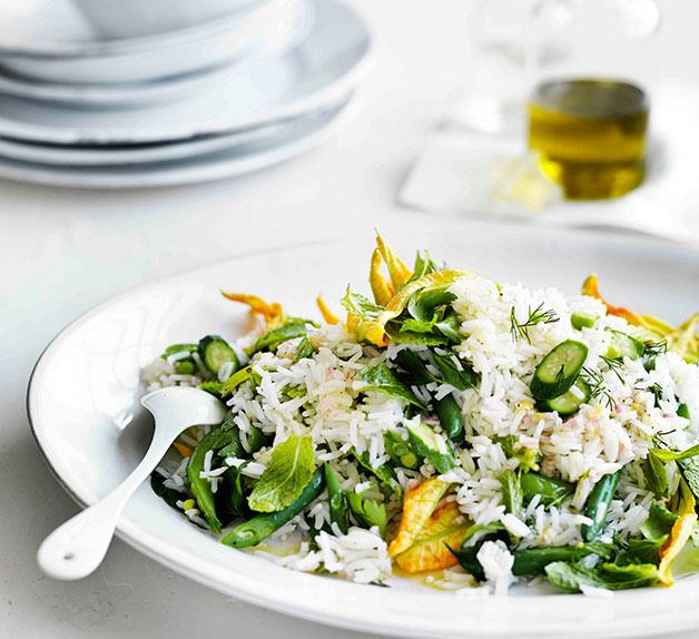 Rice salad with zucchini flowers, peas, beans and mint