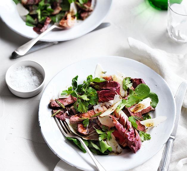 Tagliata salad with warm garlic and anchovy dressing