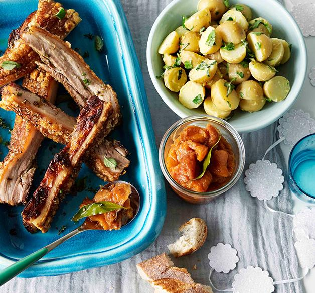 Roast pork belly with peach relish and potato and parsley salad