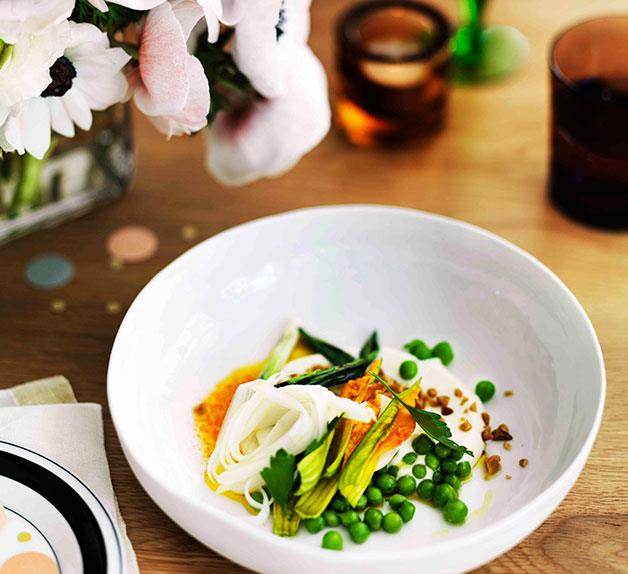 Pea salad, curd, pine nuts, blossoms, white asparagus and carrot juice dressing