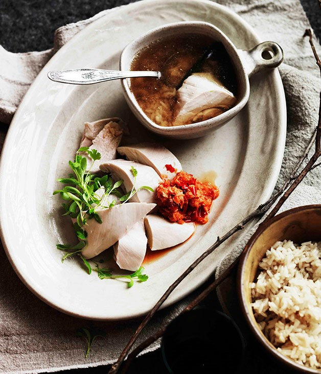 Poached chicken, rice and ginger-scented broth