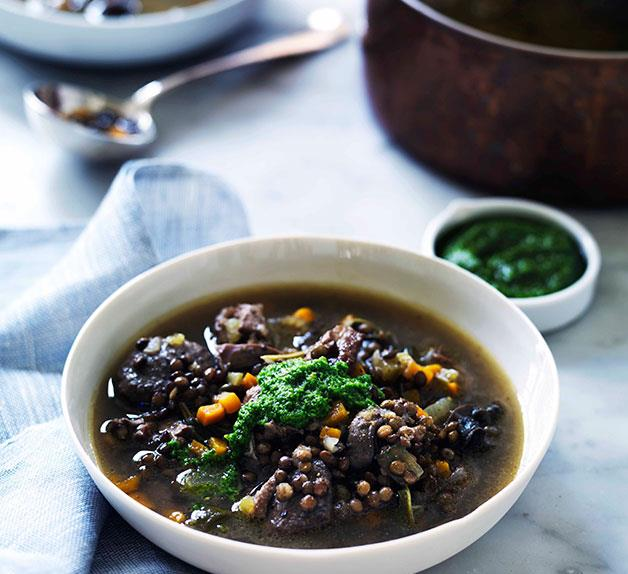 Duck, lentil and snail soup with garlic and parsley oil