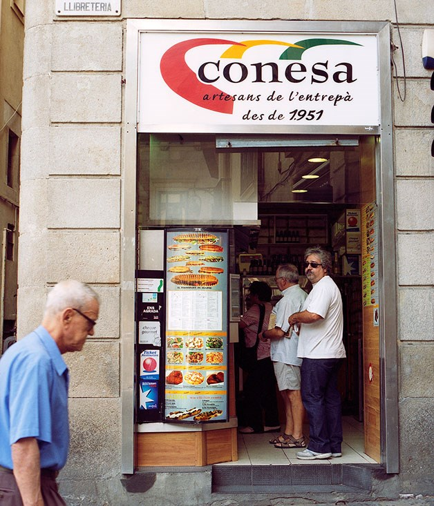 **Conesa** Go early - or late - to avoid the queues at Conesa, the best sandwich shop in town. Revenous public servants queue here from 11.30am for toasted baguettes with black sausage and onion, butifarra negra amb ceba. (Carrer de la Llibreteria.)