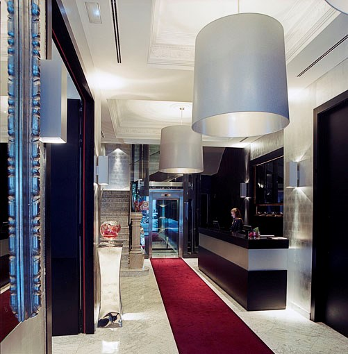 **Hotel Murmuri, Barcelona** **Hotel Murmuri, Barcelona, Spain**   Trust Spain's most flamboyant city to embrace a haven of urban chic on the Rambla catwalk. The Murmuri's 19th-century façade conceals 53 rooms and five one- and two-bedroom apartments, each decked in grainy woods and velvety fabrics by British designer Kelly Hoppen. The hotel's Bar Marfil is a hit with guests and locals alike, so expect a house-party vibe at weekends, fuelled by Thai chef Ian Chalermkittickai's sushi and Asian-inspired tapas.   Room to book: Superior rooms have a bird's-eye view over the Rambla and more space than the compact standards.   Rambla de Catalunya 104, Barcelona, Spain, +34 935 500 600, **[murmuri.com](http://www.murmuri.com)**. Classic rooms from $235 per night.      PHOTOGRAPH **SHARYN CAIRNS**