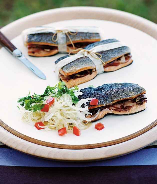 Barbecue trout bundles with prosciutto and button mushrooms