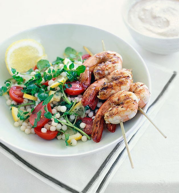 Warm moghrabieh salad with barbecued prawn brochettes and almond tarator