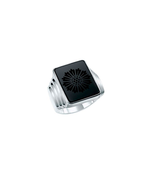 "**** Tiffany & Co. ""Daisy"" ring in sterling silver and carved black onyx, $885."