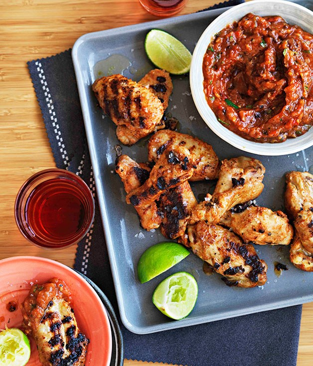 **Spiced chicken wings with roast garlic and chipotle salsa**