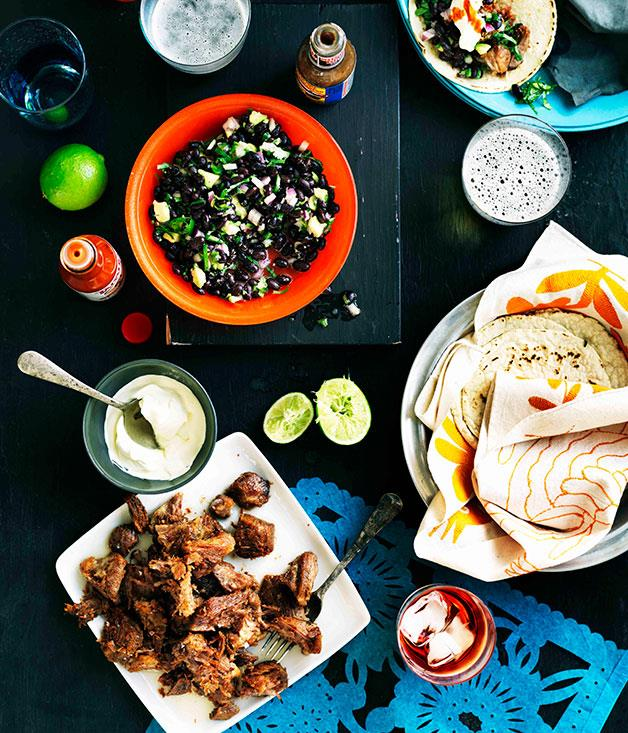"""[**Carnitas tacos with black bean salad**](https://www.gourmettraveller.com.au/recipes/browse-all/carnitas-tacos-with-black-bean-salad-11193