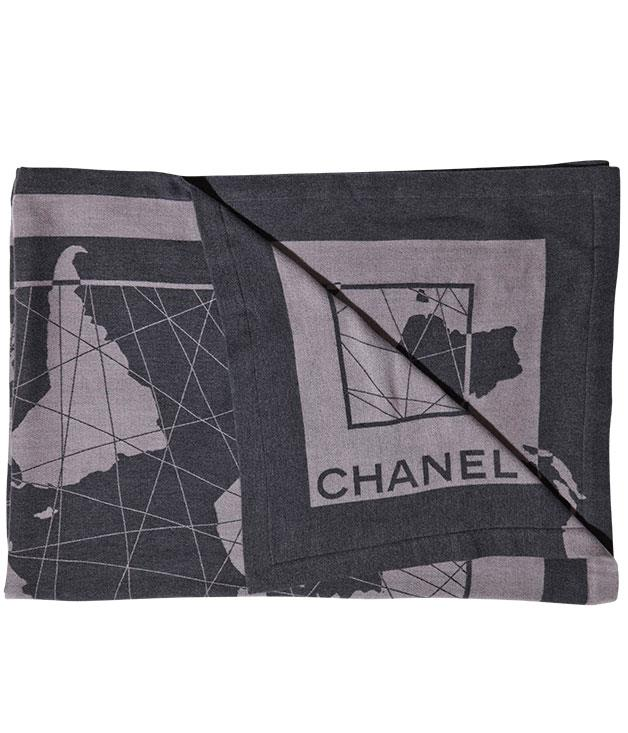 **** This Chanel travel wrap also makes a cosy blanket when you're away taking on the world. The wool and silk piece, embellished with a global map, costs $1390. 1300 242 635.