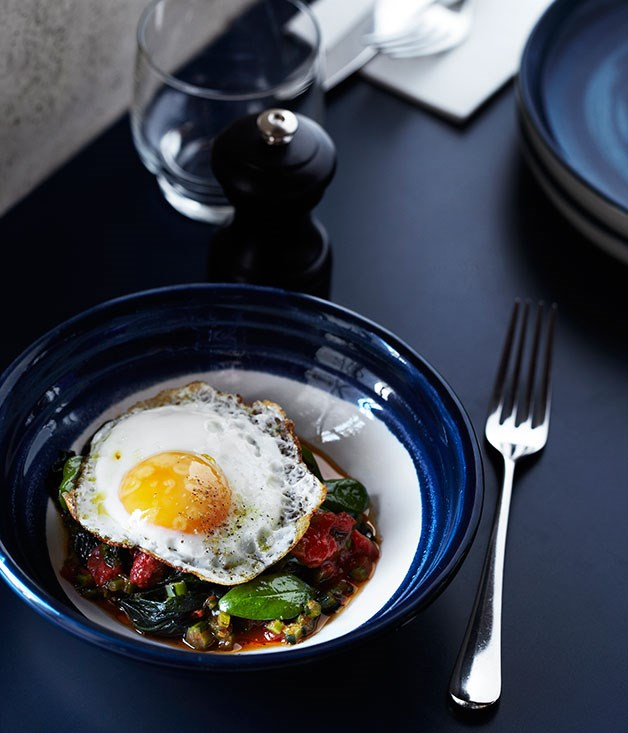Wild greens, tomato sauce and fried egg