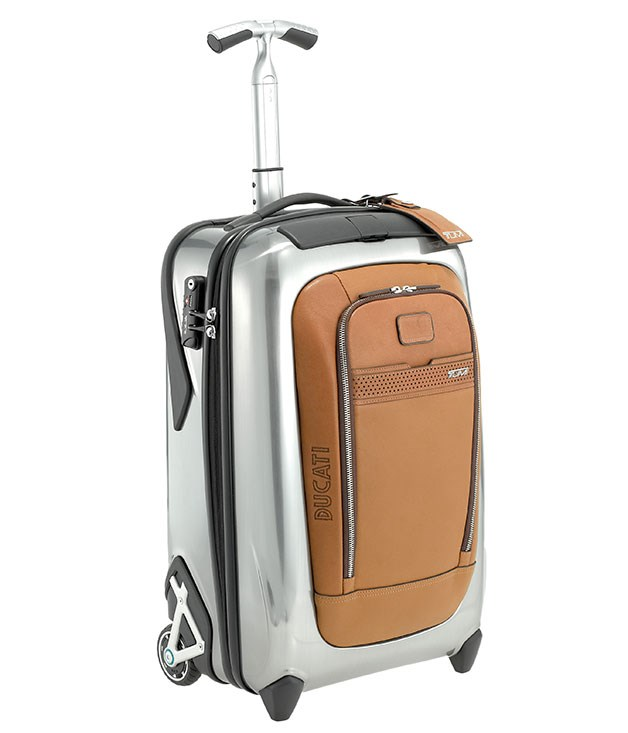 "**DUCATI FOR TUMI SUITCASE** For the man on the move, this carry-on suitcase from Tumi's Ducati collection is as nifty as they come, fitted with pockets and compartments in all the right places. _$995, [tumi.com](http://www.tumi.com ""Tumi"")_"