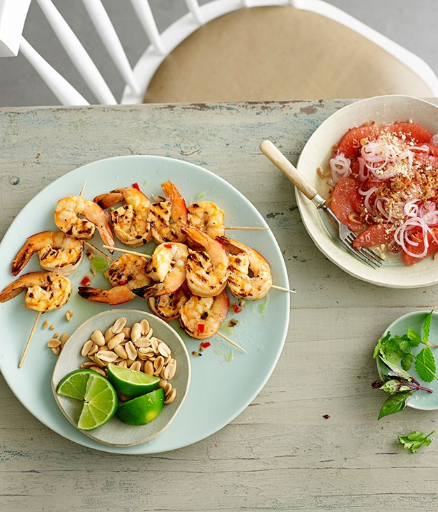 Pink grapefruit and fried shallot salad with grilled lime and chilli prawns