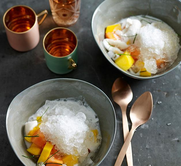 Tropical fruits with ice and salty-sweet coconut milk