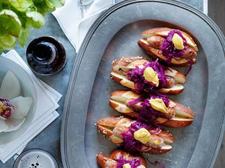 Spiced pork sausages in rolls with red cabbage