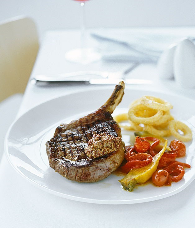 **Rib-eye steak with cornmeal onion rings and charred tomato salad**