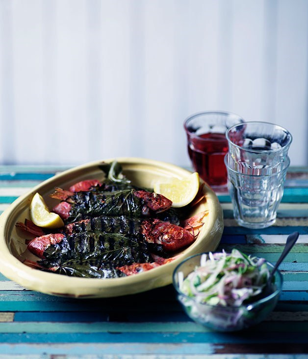 **Barbecued barbounia in vine leaves with onion salad**