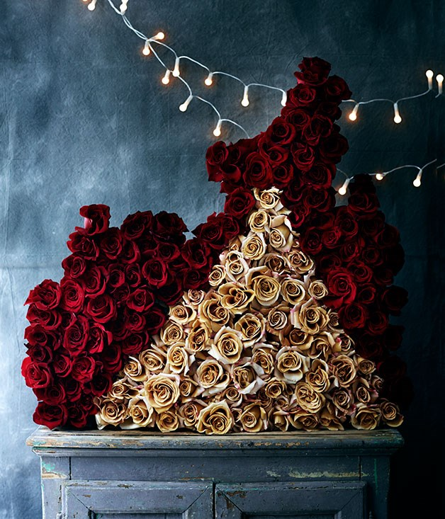 "**** ""I like the idea of architectural floral arrangements. This is my version of a gothic Christmas. There is a medieval sense of decadence and absurdity, particularly when using such a vast number of roses to celebrate this one day in the year. I'm Italian, though, so it figures."" Lisa Cooper, [Doctor Cooper Studio](http://www.doctorcooper.com.au ""Doctor Cooper Studio"")      Cupboard from [Ici et Là](http://www.icietla.com.au ""Ici et La"") . Fairy lights stylist's own."