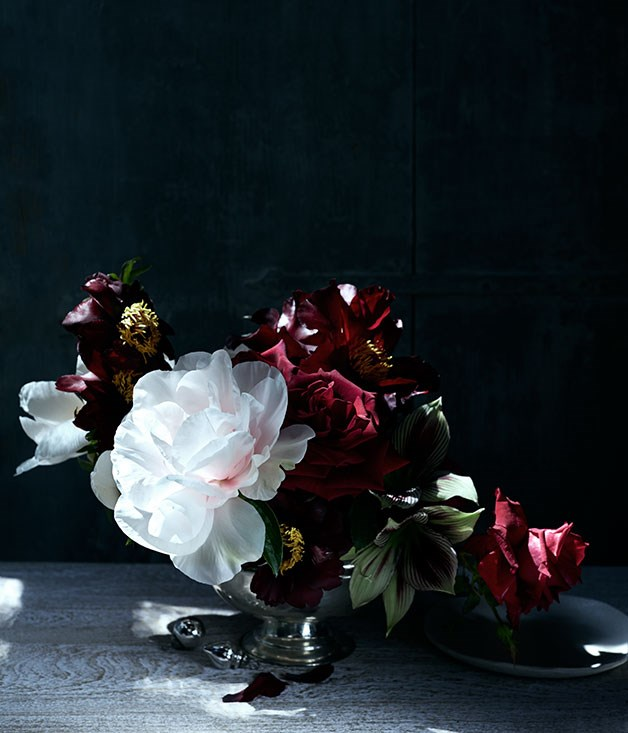 "**** ""I love roses and tree peonies. For me this brings back memories of Christmas Day, gathering flowers from my grandparents' garden and placing small bouquets around the house. I would place them on the table in little vases and glasses found in their beautifully displayed glass cabinets. Roses are always part of my Christmas."" Simone Gooch, [Fjura](http://www.fjura.com ""Fjura"")      Entrée plate from [The Fortynine Studio](http://www.thefortynine.com.au ""The Forty Nine Studio""). Vase florist's own."