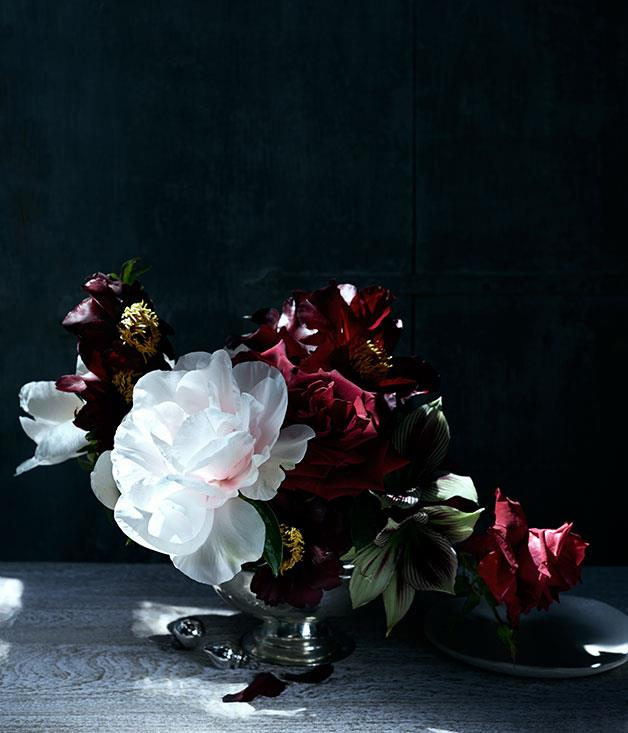 """**** """"I love roses and tree peonies. For me this brings back memories of Christmas Day, gathering flowers from my grandparents' garden and placing small bouquets around the house. I would place them on the table in little vases and glasses found in their beautifully displayed glass cabinets. Roses are always part of my Christmas."""" Simone Gooch, [Fjura](http://www.fjura.com """"Fjura"""")      Entrée plate from [The Fortynine Studio](http://www.thefortynine.com.au """"The Forty Nine Studio""""). Vase florist's own."""