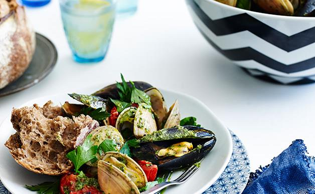 Mussels and clams with grilled tomatoes, butter and herbs