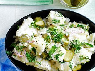 Old-school German-style crushed potato salad with dill pickles
