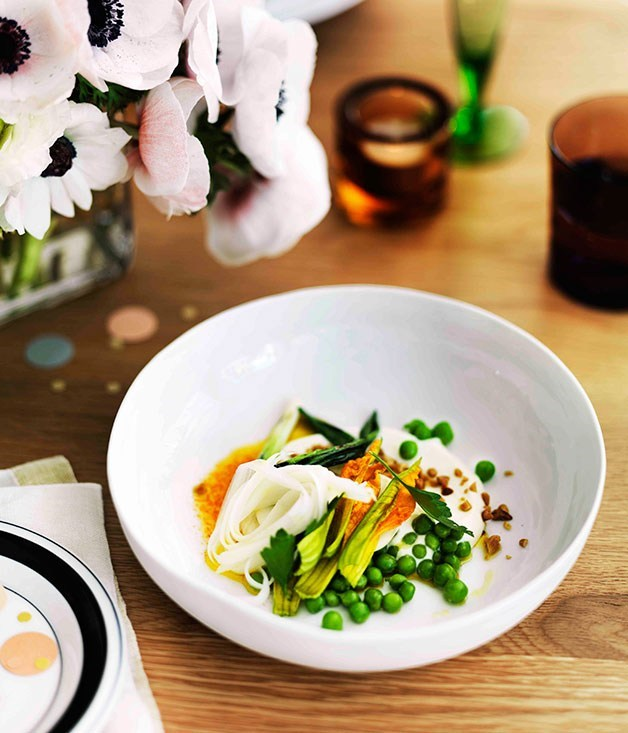 **Pea salad, curd, pine nuts, blossoms, white asparagus and carrot juice dressing**