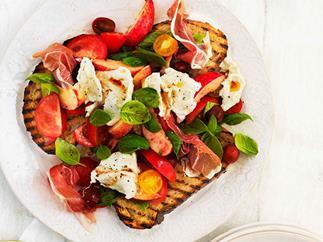 Tomato, prosciutto, peach, basil and mozzarella salad on bruschetta