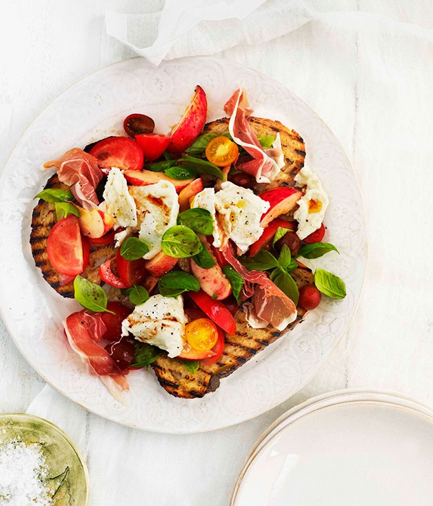 Tomato, prosciutto, peach, basil and mozzarella salad on bruschetta