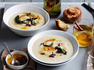 Roast garlic and parsnip soup with lemon butter and sage