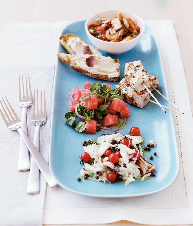 Swordfish kebabs with watermelon salad (pictured with school prawn saganaki, taramasalata toast and crab salad with cherry tomatoes and capers)