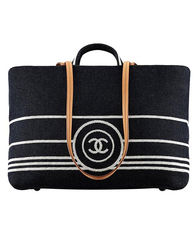 """**Chanel bag** Looking for something to cart all your beach and pool gear around in? Try this dark denim tote from Chanel. It comes with a handy leather strap and plenty of space for all your towel, book, and sunblock needs. _$2600,_ [_chanel.com_](http://www.chanel.com.au """"Chanel"""")"""