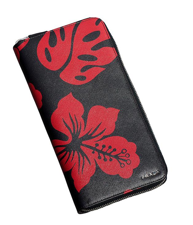 **Prada travel wallet** Planning a trip with your loved one? This tropical travel wallet from Prada will have them looking and feeling like the sharpest traveller in the terminal. _$790, (02) 9223 1688_
