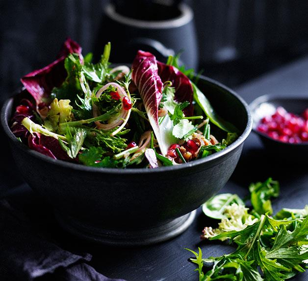 Mixed tender leaf salad with pomegranate and walnuts