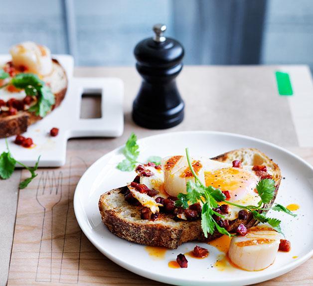 Scallops, chorizo and fried eggs on toast