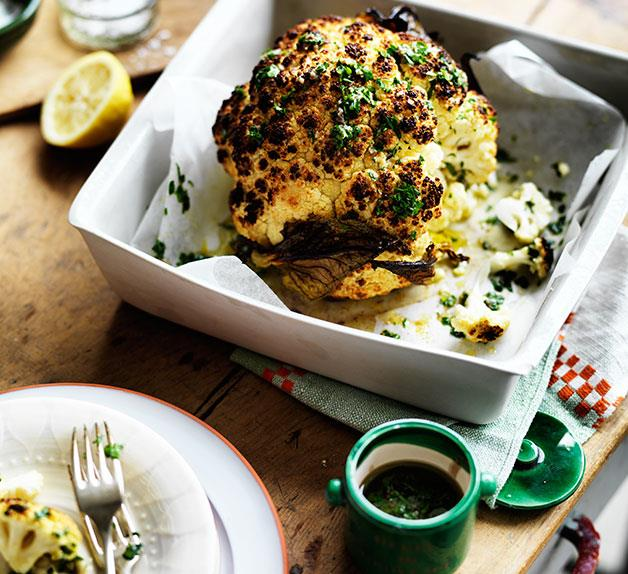 Whole roast cauliflower with parsley and anchovy sauce