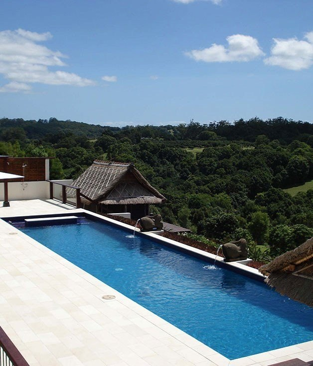 **Emerald Valley Villa** Located in the hinterland of Byron Bay, at the crest of a dramatically twisting road, [Emerald Valley Villa](http://www.emeraldvalleyvilla.com/index_new.htm) resembles a sumptuous retreat in Ubud. Teak furniture, marble floors, thatched cabanas and stone friezes depicting Hindu deities, evoke the kind of exotic headiness that typically requires an international flight. The fact that such splendour comes in an eco-sensitive package makes it even more appealing, as judicious travellers search for ways to pamper themselves and preserve the environment at the same time.