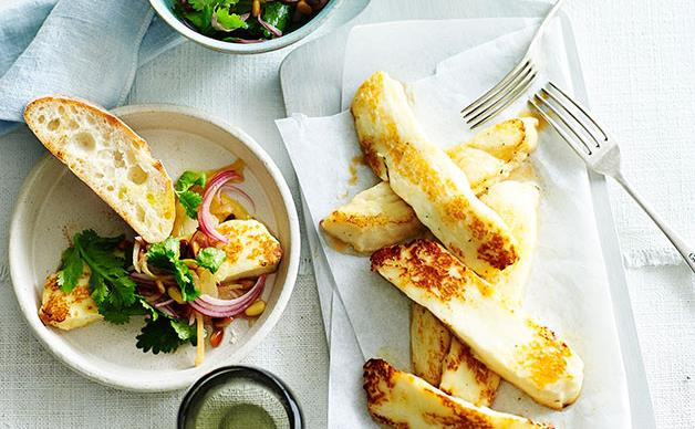 Fried haloumi with lemon, coriander and pine nuts
