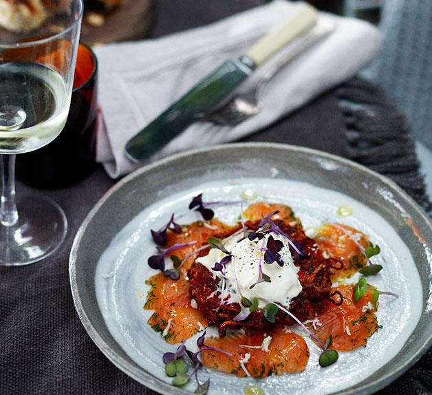 Dill-cured rainbow trout with beetroot and potato cakes and fresh horseradish